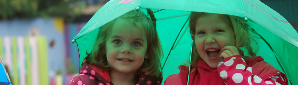 Children under an umbrella